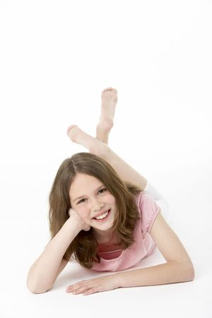 preteen girls: Young Girl Lying On Stomach In Studio