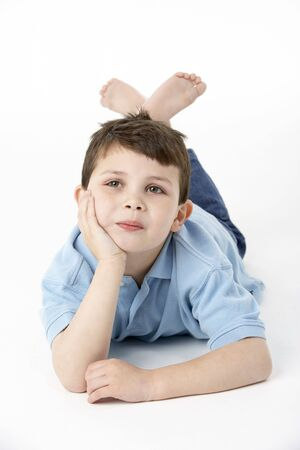 Young Boy Lying On Stomach In Studio photo