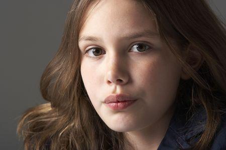 Thoughtful Girl Sitting In Studio photo