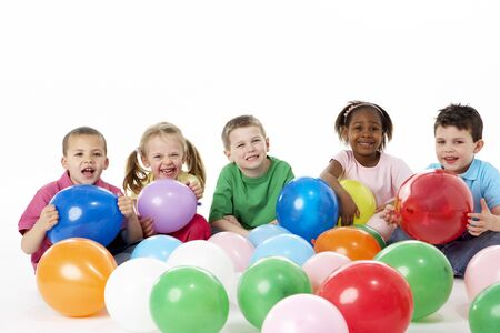 Group Of Young Children In Studio With Balloons Stock Photo - 5296950