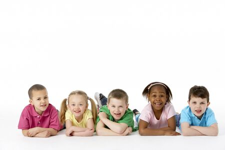 girl lying: Group Of Young Children In Studio Stock Photo