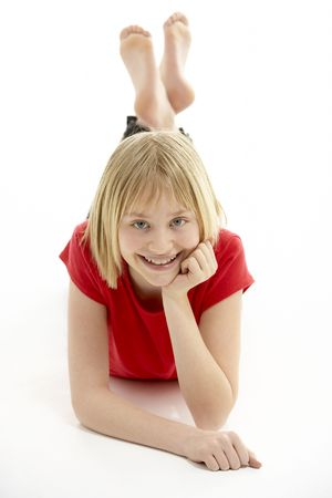 mischievious: Young Girl Lying On Stomach In Studio