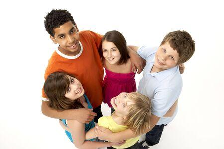 preteen boy: Group Of Five Young Children In Studio Stock Photo