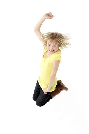 casual clothing 12 year old: Teenage Girl Leaping In Studio
