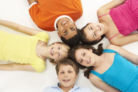 frienship: Overhead View Of Five Young Children In Studio Stock Photo
