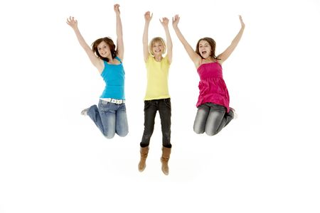 frienship: Group Of Three Young Girls Leaping In Air Stock Photo