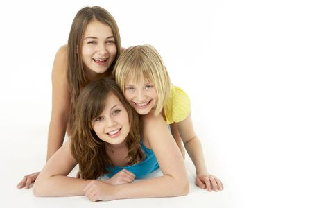Group Of Three Young Girls In Studio photo