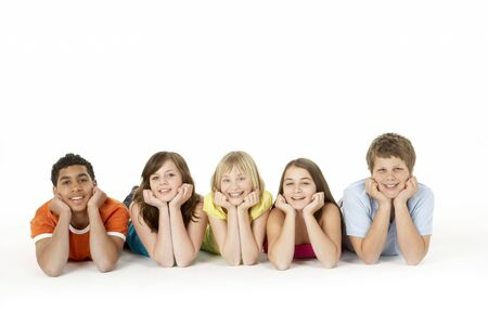 preteen boy: Group Of Five Young Children In Studio Stock Photo