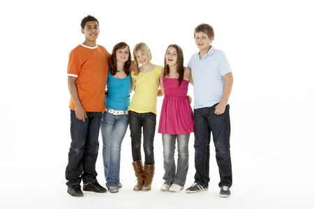 casual clothing 12 year old: Group Of Five Young Children In Studio Stock Photo