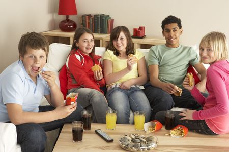 boy 12 year old: Group Of Children Eating Burgers At Home