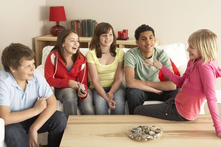 frienship: Group Of Children ChattingAt Home