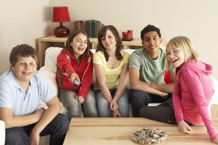 frienship: Group Of Children Watching TV At Home