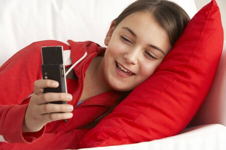 Young Girl Reading Text Message Stock Photo - 5297350
