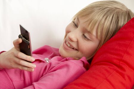 Young Girl Reading Text Message Stock Photo - 5297324