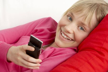 Young Girl Reading Text Message photo