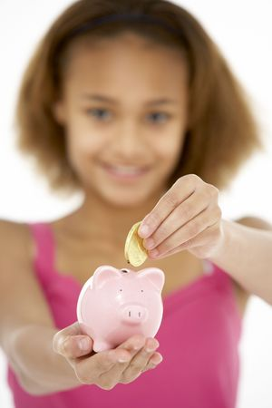 Young Girl Holding Piggy Bank photo