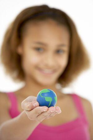 Young Girl Hoiding Small Globe photo