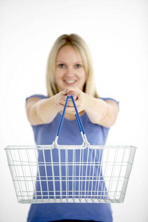Woman Holding Shopping Basket Stock Photo