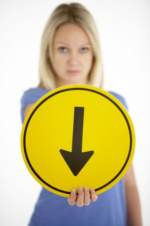 Woman Holding Road Traffic Sign photo