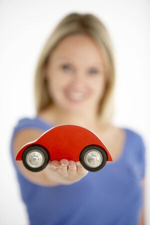 toy car: Woman Holding Toy Car