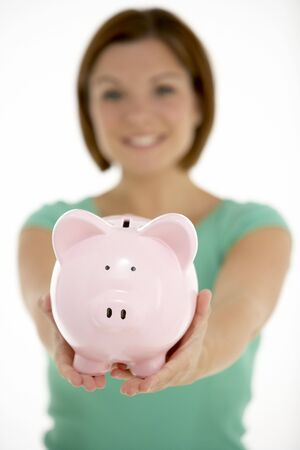 Woman Holding Piggy Bank photo
