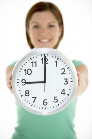 o�??clock: Reloj mujer celebraci�n Listado 9 horas Foto de archivo