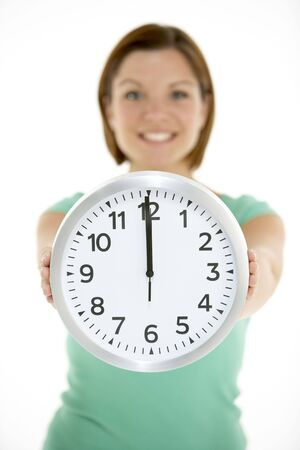 oclock: Woman Holding Clock Showing 12 OClock