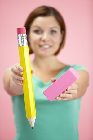 eraser: Woman Holding Big Pencil And Eraser
