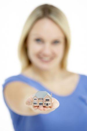 model house: Woman Holding Model House