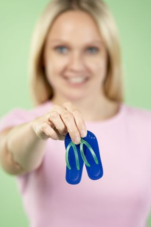 woman sandals: Woman Holding Small Beach Sandals Stock Photo