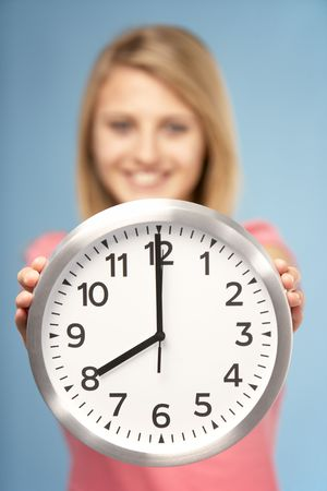girls youth: Teenage Girl Holding Clock