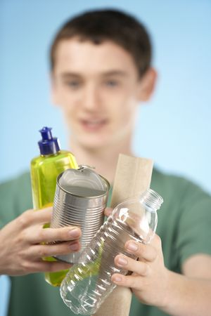 boy 15 year old: Teenage Boy Holding Recycling