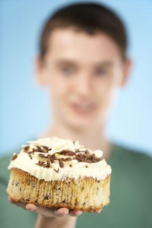 15 year old: Teenage Boy Holding Cream Cake Stock Photo