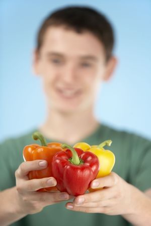 fifteen year old: Teenage Boy Holding Fresh Peppers