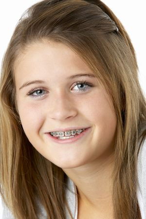 Portrait Of Smiling Teenage Girl With Braces Stock Photo