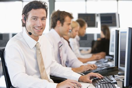 traders: Stock Traders Working At Computers
