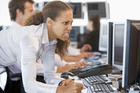 stock trader: Angry Stock Trader Looking At Screen Stock Photo
