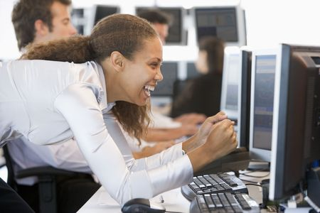 trader: Stock Trader Overjoyed Looking At Monitor Stock Photo