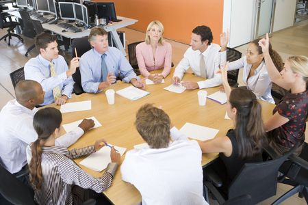 mid thirties: Stock Traders In A Meeting