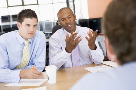 business people meeting: Stock Traders Conducting Interview Stock Photo