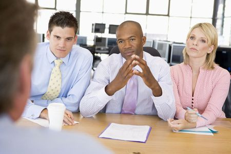 sitting at desk: Stock Traders Conducting Interview Stock Photo