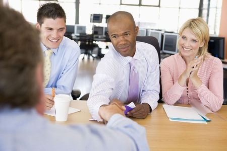 traders: Stock Traders Conducting Interview Stock Photo