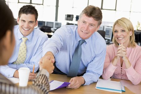 mid thirties: Stock Traders Conducting Interview Stock Photo