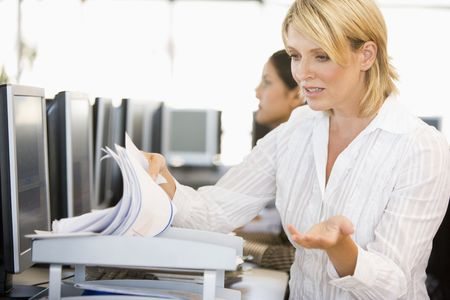 stock trader: Stock Trader Going Through Paperwork