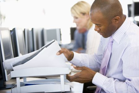 stock trader: Stock Trader Looking Though Paperwork Stock Photo