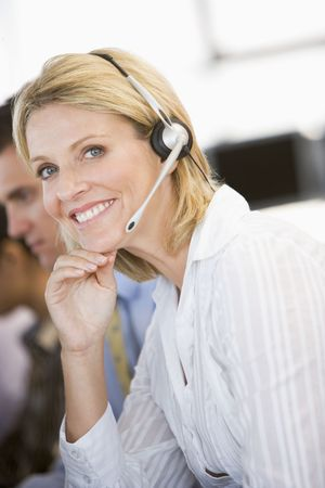 traders: Stock Traders With Headsets At Work