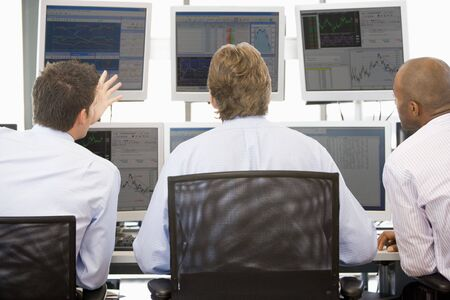 Stock Traders Viewing Monitors photo