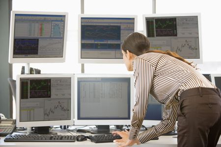 stock trader: Stock Trader Examining Computer Monitors Stock Photo