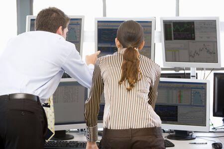 Stock Traders Viewing Monitors photo