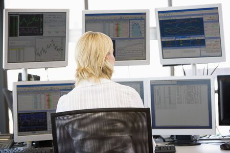 Stock Trader Looking At Multiple Monitors photo